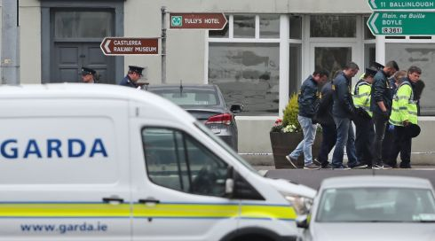 SHOOTING: Garda at the scene in Castlerea, Co Roscommon, where Det Gda Colm Horkan died after being shot on Wednesday night. Gardaí have detained a man in connection with the incident. Photograph: Niall Carson/PA Wire
