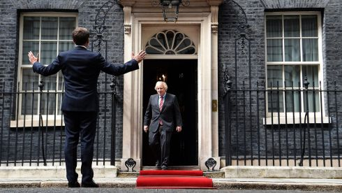 BONJOUR: British prime minister Boris Johnson (right) welcomes French president Emmanuel Macron to 10 Downing Street in London on Thursday. Mr Macron is in London to mark the 80th anniversary of former French president Charles de Gaulle's appeal to French people to resist the Nazi occupation during the second World War. Photograph: Andy Rain/EPA