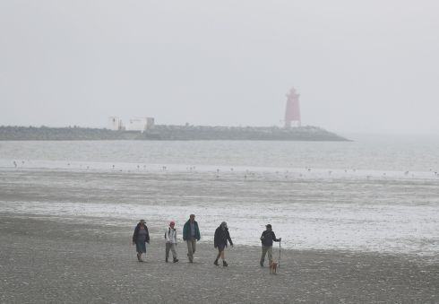 SEASIDE: Walkers on Poolbeg Strand. Photograph: Nick Bradshaw/The Irish Times