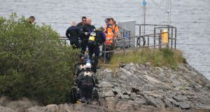 Members of the Coast Guard during the search at Lough Keel in Donegal, where a father and son  died. Photograph: North West Newspix