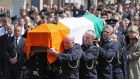 The coffin of Detective Garda Colm Horkan is carried to St James' church in Charlestown, Co Mayo. Photograph: Brian Lawless/PA Wire