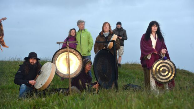 Brian Cunning, Lisa Dunne, Caroline Jeffrey and Lorna Evers at the summer solstice celebrations on the Hill of Tara, Co Meath. Photograph: Dara Mac Dónaill/The Irish Times.