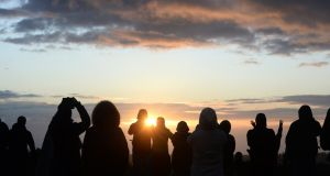 A crowd gathers on the Hill of Tara in Co Meath for the summer solstice celebrations. Photograph: Dara Mac Dónaill/The Irish Times.