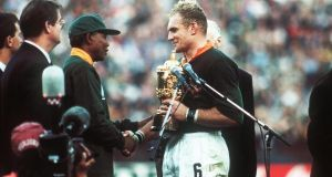 Nelson Mandela hands the Webb Ellis trophy to Francois Pienaar in 1995. Photograph: Billy Stickland/Inpho