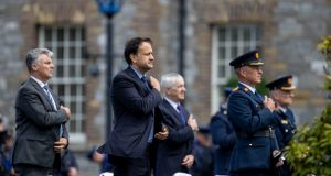 Taoiseach Leo Varadkar (centre) marks the minute's silence for late Garda Colm Horkan at Garda headquarters in the Phoenix Park. Photograph: Tom Honan