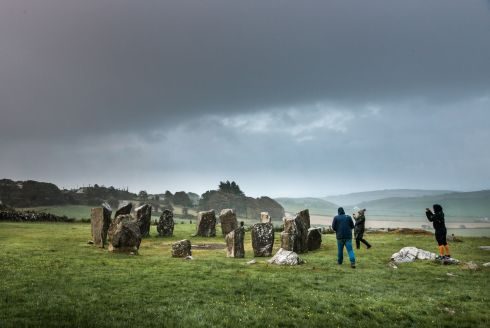 Between rain showers a quick burst of light begins to illuminate the standing stones at Sunrise during the summer solstice at Drombeg Stone Circle outside Glandore, County Cork, Ireland. Photograph David Creedon / Anzenberger