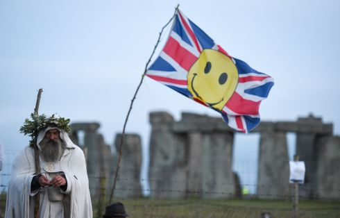 Druid Merlin at Stonehenge as the sun sets ahead of Summer Solstice on June 20, 2020 in Amesbury, United Kingdom. Stonehenge remained closed for Summer Solstice 2020 due to the on-going ban on mass gatherings and the need to maintain social distancing caused by the Covid 19 / Coronavirus pandemic. Photograph Finnbarr Webster/Getty Images