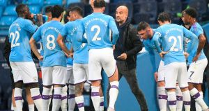 Pep Guardiola speaks to his players during Manchester City's win over Arsenal. Photograph: Peter Powell/AFP/Getty