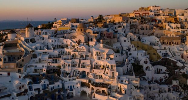 Sunset in the town of Oia on the Greek island of Santorini. Photograph: Aris Messinis/AFP via Getty Images