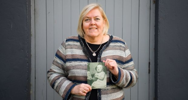 Teresa O'Sullivan holding a photograph of herself  aged 18 months. Photograph: Diarmuid Greene