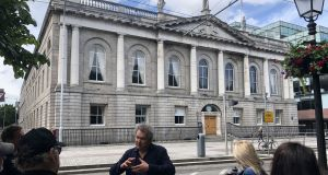 Arran Henderson getting a word in edgeways in front of the Royal College of Surgeons in Dublin