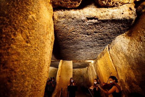 MUSICAL CAVE: A string quartet performs inside one of the dolmens at the Antequera Dolmen archaeological site, in Antequera, Malaga, southern Spain. The archaeological site is to reopen to the public on June 24th following three months of closure due to the coronavirus lockdown. Photograph: Jorge Zapata/EPA