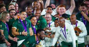South Africa captain Siya Kolisi lifts the Webb Ellis Trophy after the Springboks' final victory over England. Photograph: James Crombie/Inpho