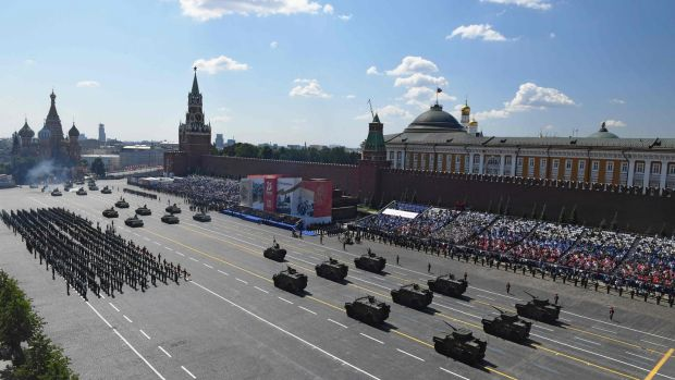Military vehicles moving through Red Square. Photograph: Mikhail Voskresenskiy/Host photo agency/AFP via Getty Images