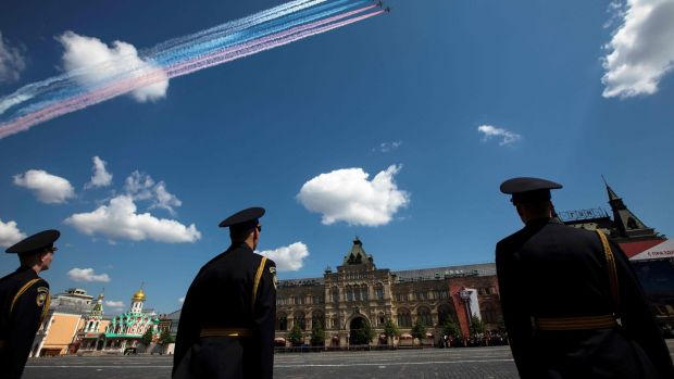 Sukhoi Su-25 assault aircrafts release smoke in the colours of the Russian flag over Red Square. Photograph: Pavel Golovkin/POOL/AFP via Getty Images