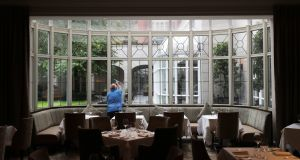 Window cleaning at the InterContinental prior to re-opening. Photograph: Nick Bradshaw/ The Irish Times