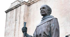 A statue of Father Junipero Serra  in front of the San Gabriel Mission in San Gabriel, California.   A statue of Serra in nearby Golden Gate Park was torn down by protesters last Friday. Photograph:  Frederic J. Brown/AFP/via Getty Images