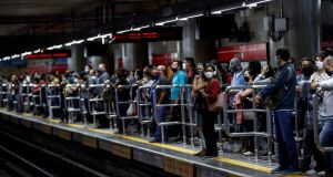 "Passengers at the Se metro station in downtown Sao Paulo. Brazil's health ministry said recent data points to a ""significant increase"" in new cases of Covid-19. Photograph: Sebastiao Moreira/EPA"