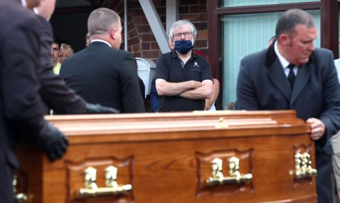 Gerry Adams looks on as the body of leading republican Bobby Storey is returned to his Anderstown home in Belfast this evening. Photograph: Stephen Davison