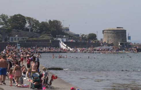 Beachgoers at Dublin's Seapoint and Monkstown beachers. Photograph: Stephen Collins/Collins Photos