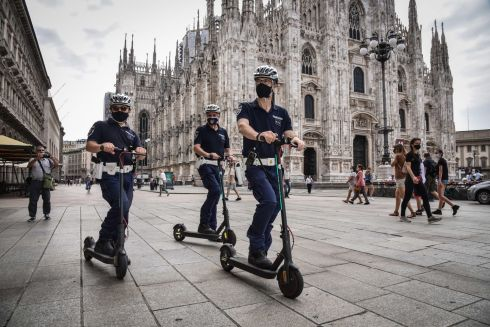 Local police officers on scooters patrol in piazza Duomo, in Milan, Italy. The new service of the local police on a scooter is dedicated to the control of pedestrian areas and cycle paths. Photograph: Matteo Corner/EPA