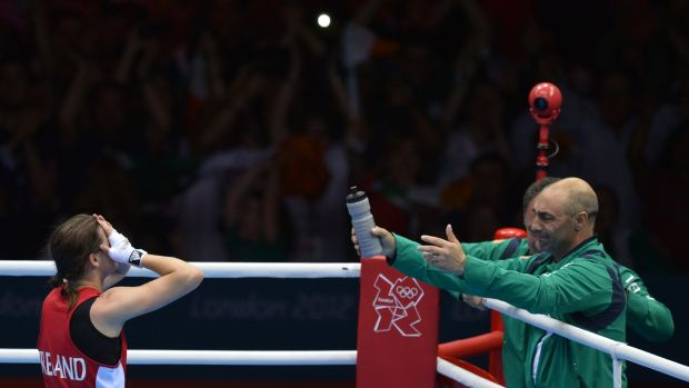 Katie Taylor walks towards her father Pete after winning the lightweight final at the 2012 London Olympics. Photograph: Alberto Pizzoli/AFP/Getty Images