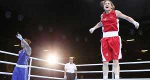 Ireland Katie Taylor jumps with joy as she celebrates her victory over Russia's  Sofya Ochigava of Russia in the women's lightweight final at the 2012 London Olympics. Photograph:  Jack Guez/AFP/Getty Images
