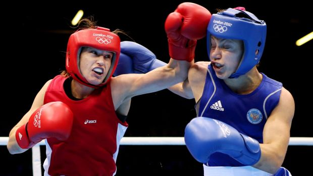 Katie Taylor exchanges punches with Sofya Ochigava during the final bout. Photograph: Scott Heavey/Getty Images