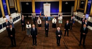 President Michael D  Higgins presents new Ministers with their Seal of Office on Saturday night.