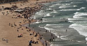 People enjoy the beach during a sunny day in Beirut, Lebanon. Photograph: Nabil Mounzer/EPA
