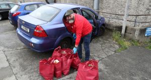 Volunteer Greg Kelly loads food parcels for delivery within the community back in April. Photograph: Nick Bradshaw