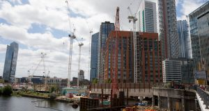 "Builders work at  Wood Wharf, London:  UK government pledges to ""Build back better, build back greener, build back faster"".  Photograph: Jason Alden/Bloomberg"
