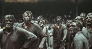 Fran Cotton in the foreground of a mud covered British Lions lineout along with Moss Keane (second left), Phil Orr (centre) and Jeff Squire (arms out) against New Zealand Juniors at the Athletic Park in Wellington in July 1977. Photograph: Adrian Murrell/Allsport/Getty Images/Hulton Archive