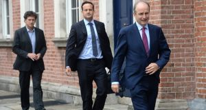 Taoiseach Micheál Martin, Tánaiste  Leo Varadkar and Minister for Climate Action, Communications Networks and Transport Eamon Ryan leave Dublin Castle following their first Cabinet meeting. Photograph: Dara Mac Dónaill