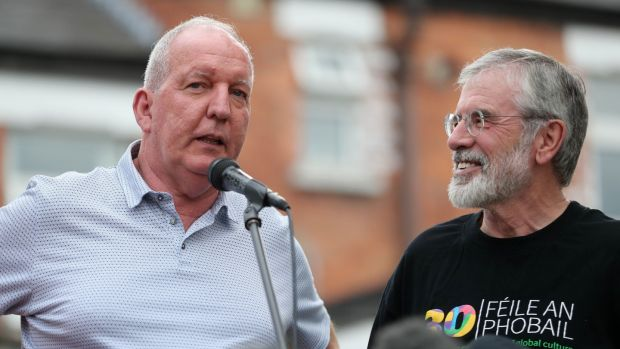 Bobby Storey and Gerry Adams address a rally beside the old Andersonstown police station, Belfast, following attacks on their homes on Friday. File photograph: Niall Carson/PA