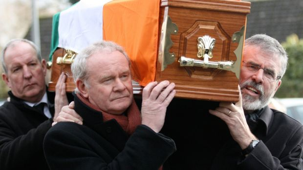 Bobby Storey, Martin McGuinness and Gerry Adams carry IRA volunteer and Sinn Féin activist 'Wee' Harry Thompson to his final resting place in 2012. Photograph: Sinn Féin