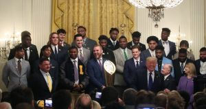 Donald Trump welcomes the Clemson team that won last year's college football championship to the White House. Photo: Mark Wilson/Getty Images