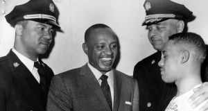Two black police officers with African-American jazz musician and actor Lionel Hampton in 1957. Photograph:  Afro American Newspapers/Gado/Getty Images)