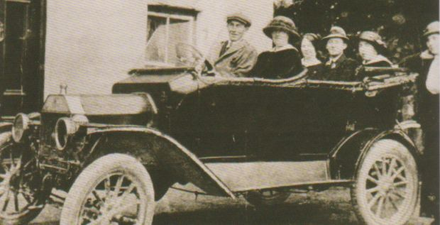 Photo of the first car in Glenamaddy owned by Tommy Collins of the Imperial Hotel from Glenamaddy Boyounagh, Our People, Our Heritage edited by Peadar O'Dowd.