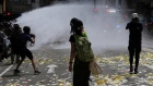 Hong Kong police fire water cannons at activists protesting new security law