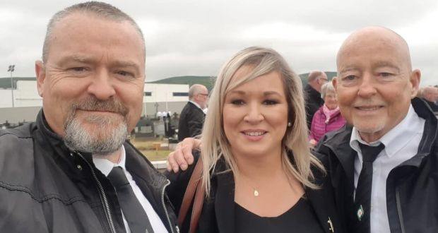 "Michelle O'Neill  accepted that what was happening in a photograph taken after the funeral and shared on social media – of herself and two men, one with his arm round her shoulder – ""shouldn't have happened"". Photograph: Handout/PA Wire"