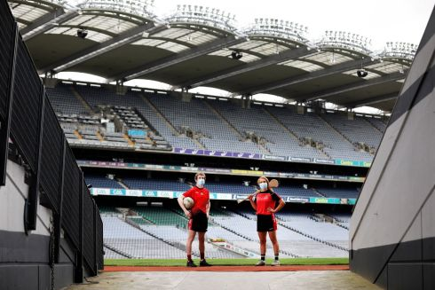 PITCH IN: RCSI students and GAA captains Hugh Woulfe and Róisín Baker are seen at Croke Park, which will host RCSI medical students this September. Photograph: Julien Behal Photography