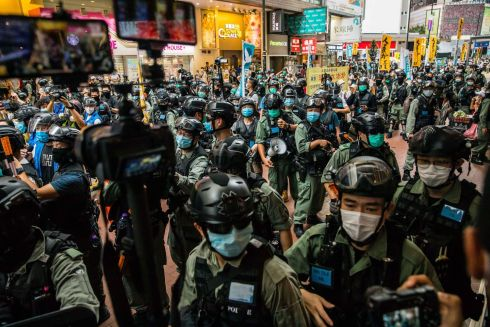 HONG KONG UNREST: Riot police clear a street as protesters gather to rally against a new national security law in Hong Kong. Photograph: Dale de la Rey/AFP via Getty Images