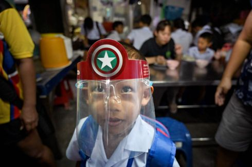 LEARNING CURVE: A student of the Makkasan Phitthaya government primary school wears a face shield as he leaves the school canteen in Bangkok. Photograph: Romeo Gacad/AFP via Getty Images