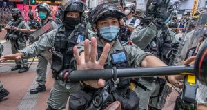 Police arrested hundreds of protesters on Wednesday in the Causeway Bay area of Hong Kong. Photograph: Lam Yik Fei/The New York Times