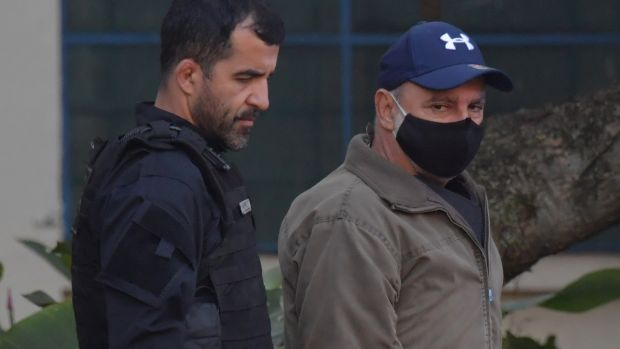 Fabricio Queiroz (right) arrives at the Legal Medicine Institute in Sao Paulo, Brazil, after his arrest. Photograph: Nelson Almeida/AFP via Getty Images