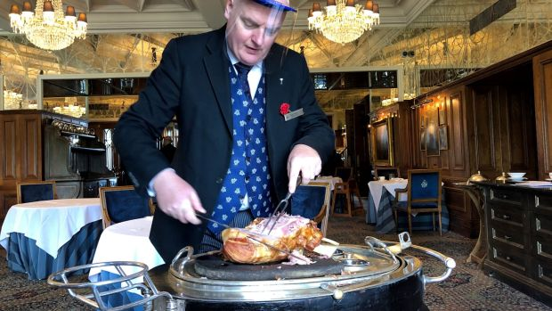 Restaurant manager Robert Lowe carves at the castle.