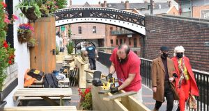 Workers preparing an outdoor seating area at a pub  in Birmingham. Photograph:  Justin Tallis/AFP via Getty Images