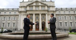 Minister for Finance Paschal Donohoe (R) and Minister for Public Expenditure Michael McGrath are seen ahead of a press conference outside Government Buildings in Dublin on Thursday. Photograph: Julien Behal/PA Wire