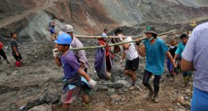 LANDSLIDE: Volunteers carry the body of a victim after a landslide at a jade mining site in Hpakant, Kachin State, Myanmar on July 2nd. According to media reports, search and rescue efforts are ongoing after a landslide at a jade mining site was triggered by heavy rain. At least 126 bodies have been found, media added. Photograph: Zaw Moe Htet/EPA